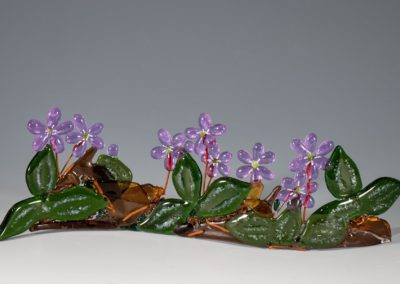 "fused-glass-tabletop-curve-""Hepatica"" by linda oeffling"