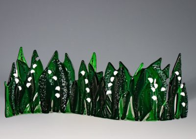 "fused-glass-tabletop-curve-""Lily of the Valley"" by linda oeffling"