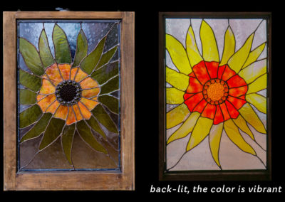 stained glass sunflower in old window frame