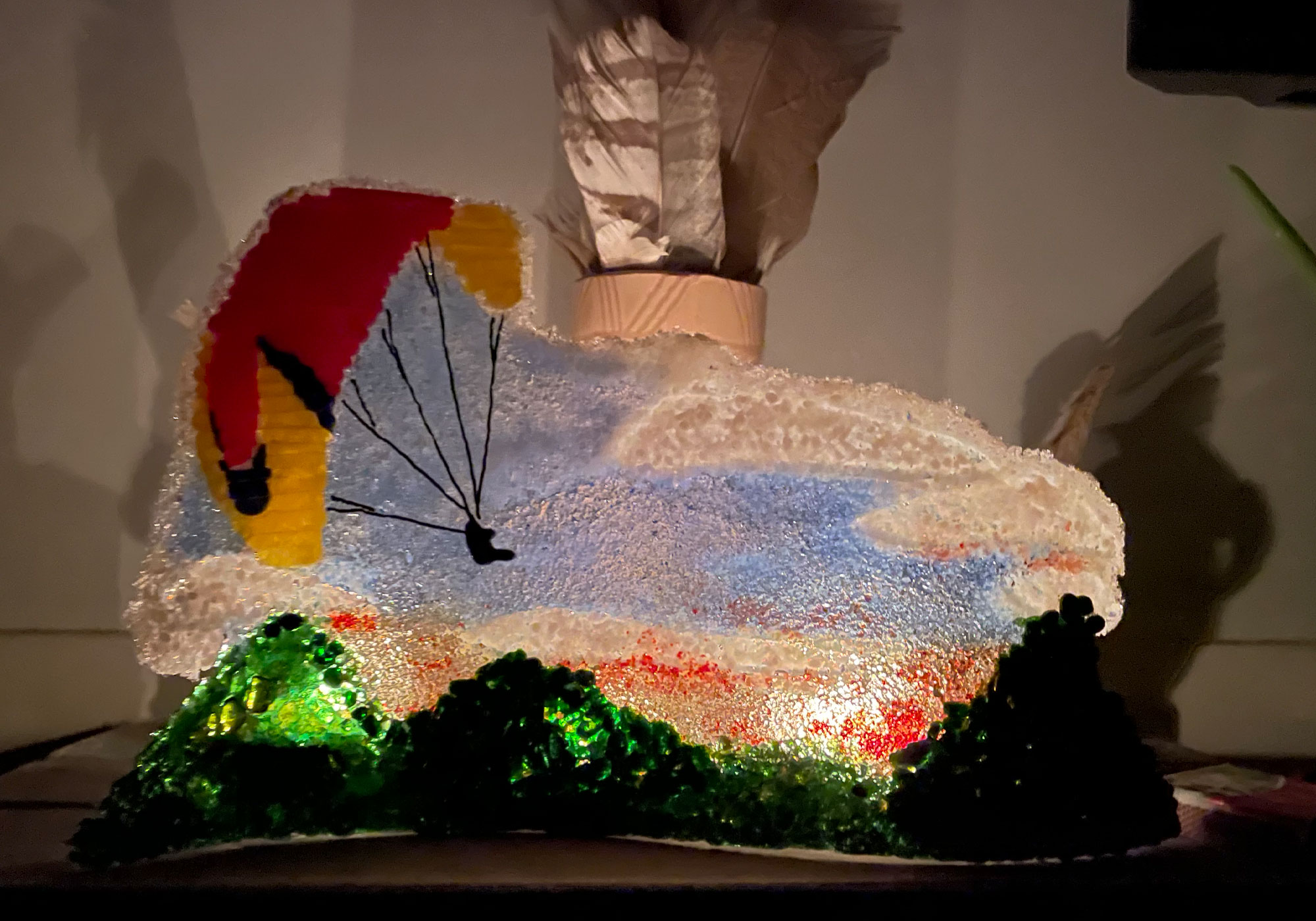 fused-glass-tabletop-curve-paragliding over mountaintops